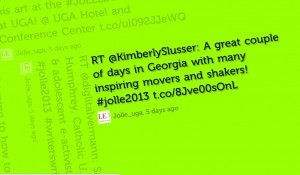 "Photograph of a tweet. Green background with black text that states ""RT@KimberlySlusser: A great couple of days in Georgia with many inspiring movers and shakers! #jolle2013"